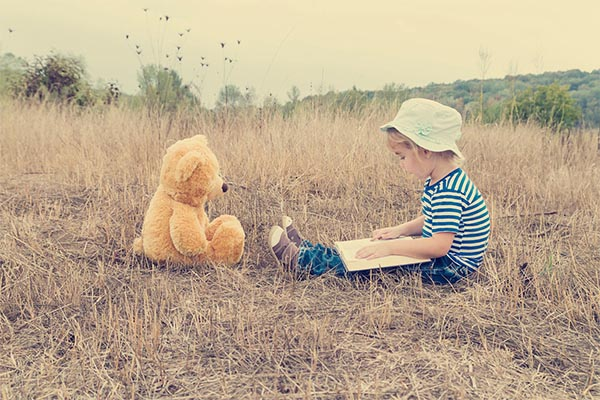 Cute girl reading book Teddy bear By Vyacheslav Vokov