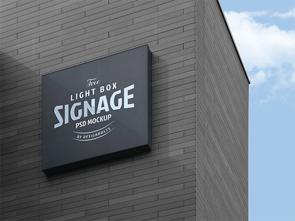 Free Wall Mounted Logo Signage Board on Building Mockup PSD