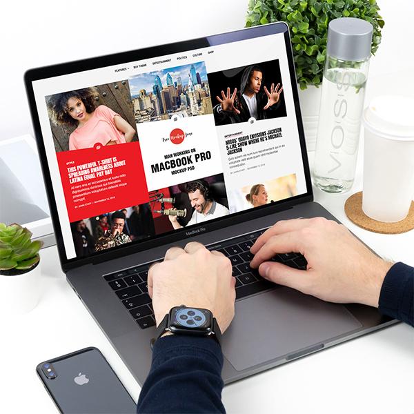 Free Man Working on MacBook Pro Mockup PSD